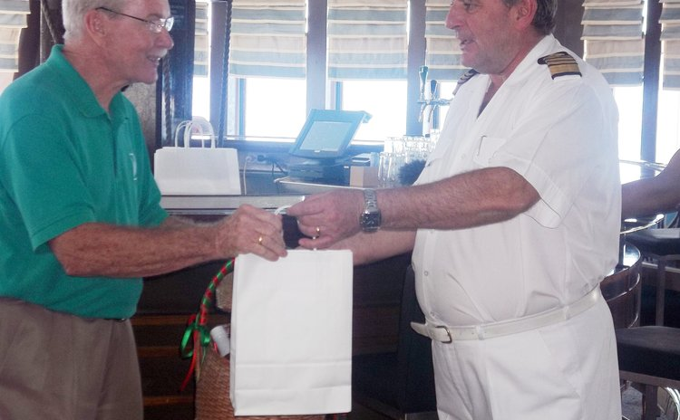 H.H.V. Whitchurch's Gairy Aird and ship's captain exchange gifts