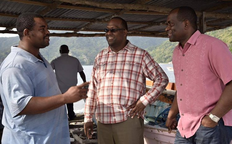 Pinard , centre, and PM Skerrit meet Soufriere man during recent visit (OPM Photo)