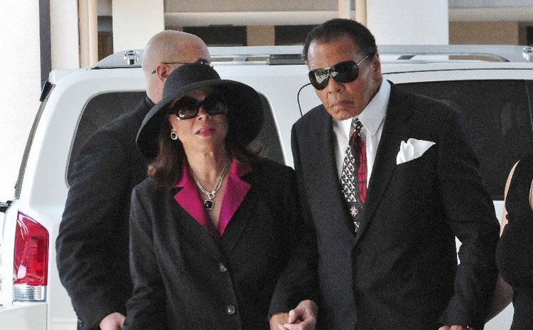 Former boxer Muhammad Ali (R) and his wife Lonnie Ali arrive for the visitation and funeral service for boxing legend Angelo Dundee at the Countryside Christian Center in Clearwater, Florida, February