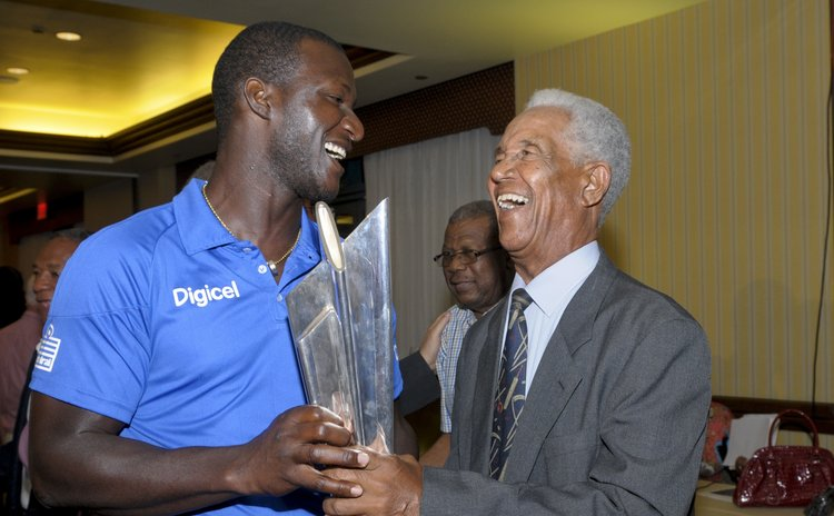 West Indies Captain Sammy and Sir Gary Sobers share a laugh