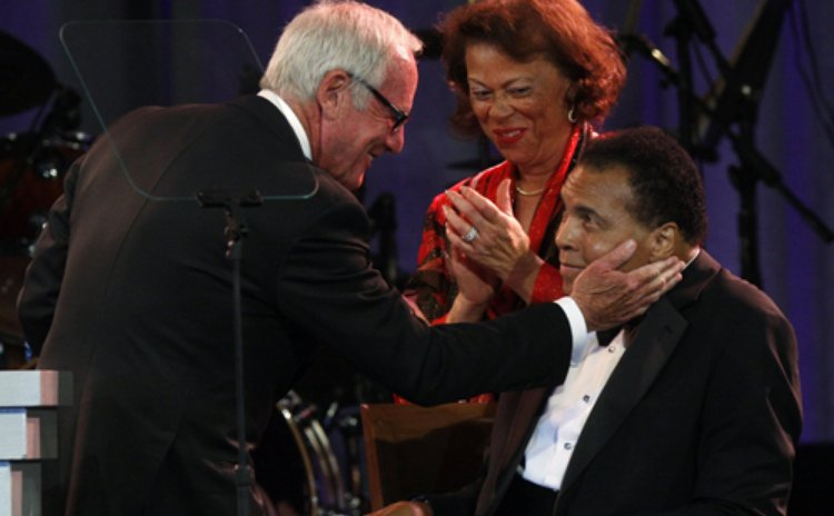 Producer Jerry Weintraub (L) touches the face of Muhammad Ali after receiving the Muhammad Ali Humanitarian Award during the Muhammad Ali Celebrity Fight Night awards banquet in Phoenix, Arizona March