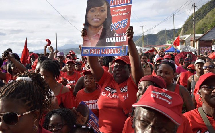 A supporter holds up a poster of the DLP candidate