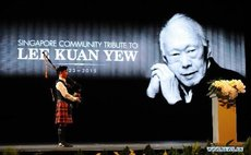 A bagpiper plays a tune during a memorial meeting of Singapore's founding father Lee Kuan Yew at Singapore's Kallang Theatre, March 27, 2015
