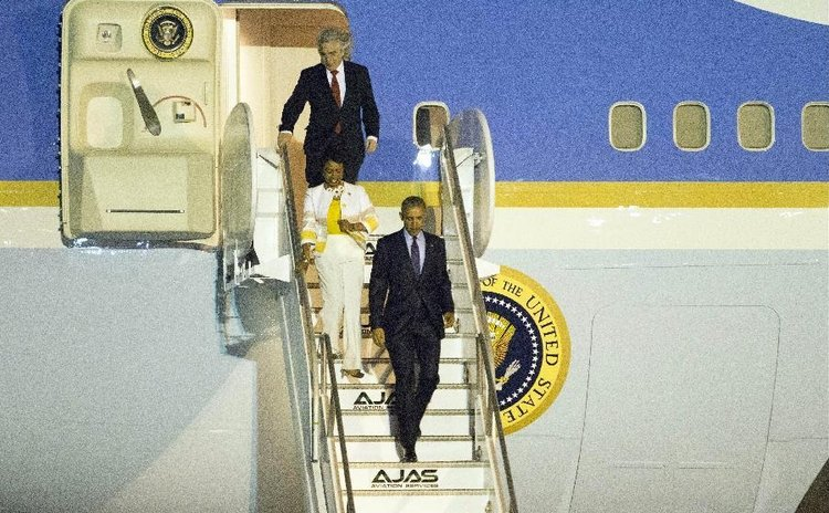 U.S. President Barack Obama (front) arrives at the Norman Manley International Airport in Kingston, Jamaica, April 8, 2015