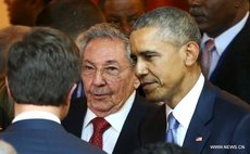 Obama, right and Raul Castro at the Summit of the Americas