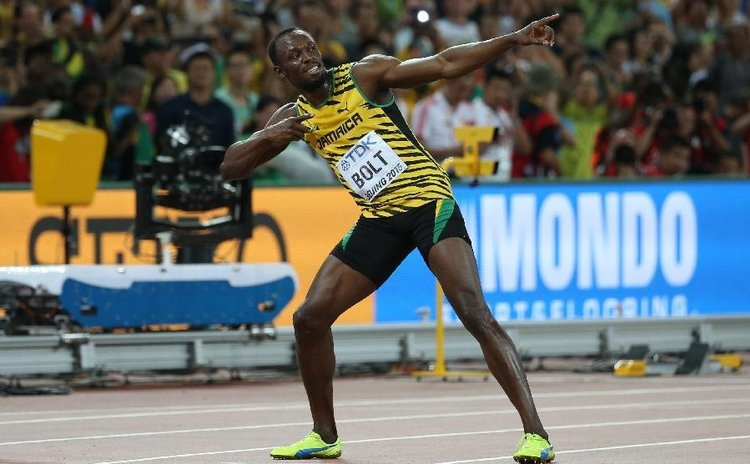 Bolt and his signature pose after winning the men's 100 metres race