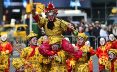 A flash mob featuring a hundred performers in monkey costumes makes an appearance to celebrate the arrival of the Chinese New Year in Times Square on Manhattan, New York, the United States, Feb. 6, 20