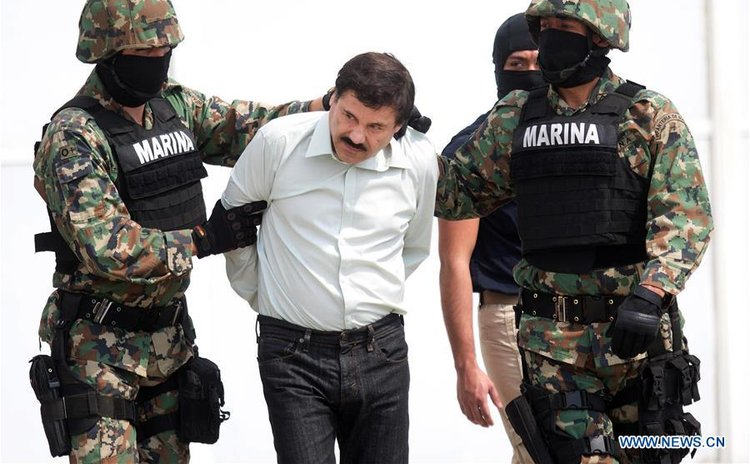 "File photo taken on Feb. 22, 2014 shows Mexico's Navy (SEMAR) members, guarding the drug trafficker Joaquin Guzman Loera, alias ""El Chapo"" Guzman (C)"