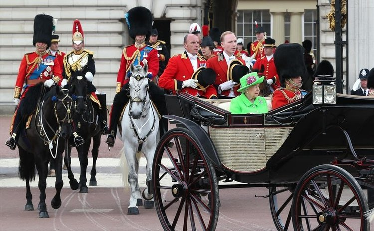 "Britain's Queen Elizabeth II and her husband Prince Philip leave Buckingham Palace to attend the Queen's Birthday Parade ""Trooping the Color"" during the Queen's 90th official birthday celebrations"