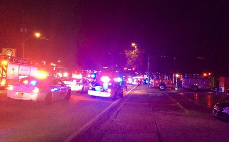 Photo provided by Orlando Police Department shows police cars and fire trucks gather outside the Pulse nightclub in Orlando, Florida, the United States, June 12, 2016
