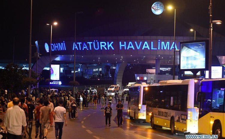 ISTANBUL, June 29, 2016(Xinhua) -- People stand at the entrance to Ataturk International Airport in Istanbul, Turkey, June 29, 2016