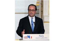 French President Francois Hollande speaks at a press conference after meeting with British Prime Minister Theresa May