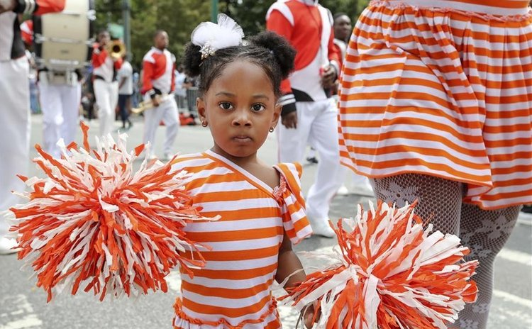 People wearing gorgeous costumes participate in the parade of Caribbean Carnival 2016 in New York, the United States on Sept. 5, 2016