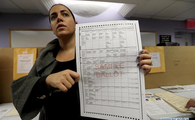 Valerie Vazquez, director of communications of the New York City board of elections, introduces the ballot-casting process for journalists during a Pre-Election Voting Demonstration on Nov. 7, 2016