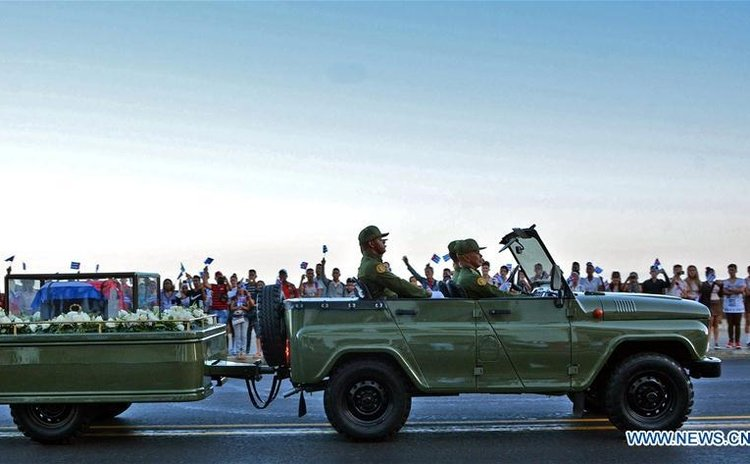 The caravan carrying the urn that holds the ashes of Cuban revolutionary leader Fidel Castro is greeted by people at Malecon Habanero Avenue in Havana, capital of Cuba, on Nov. 30, 2016