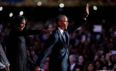 president Obama and Michele Obama wave farewell to crowd after speech