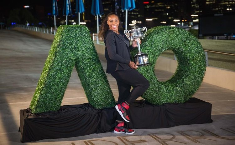 Serena Williams, poses after winning Australian Open