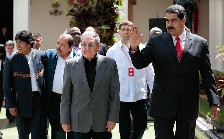 Venezuela's President Nicolas Maduro (1st R, front), Bolivia's President, Morales (1st L), Nicaragua's President Ortega (2nd L), and Cuban President Castro (2nd R, front) at ALBA meeting, Venezuela