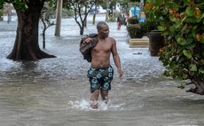 A man walks through a flooded street after the passage of Hurricane Irma, in Havana, Cuba, on Sept. 10, 2017. (Xinhua/Joaquin Hernandez)