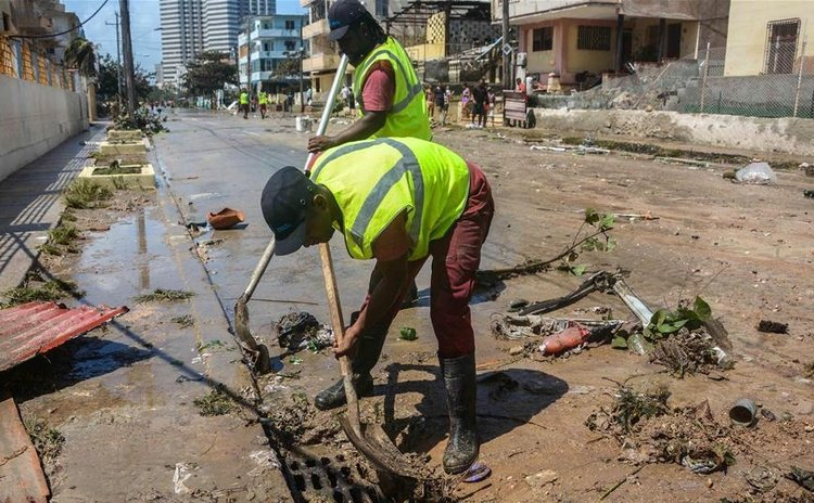 Cleaning the streets in Havana, Cuba after Hurricane Irma