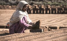 A woman works at a brick factory on the International Women's Day on the outskirts of Rawalpindi, Pakistan on March 8, 2018. (Xinhua/Saadia Seher)
