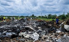 Rescuers work at the site where an airplane crashed near the Jose Marti International Airport in Havana, Cuba, on May 18