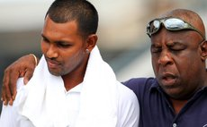 Windwards manager Lockhart Sebastien consoles Trinidad captain Danesh Ramdin after Windwards crush Trinidad to make it to the finals of the regional 4-day cricket tournament