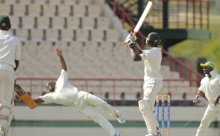 Nkrumah Bonner catches Sunil Ambris ( WICB photo)