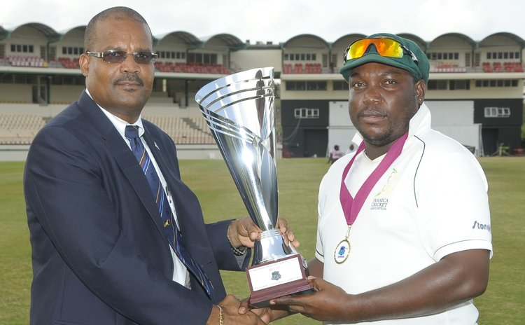 WICB vice President presents trophy to Lambert of the Jamaica team