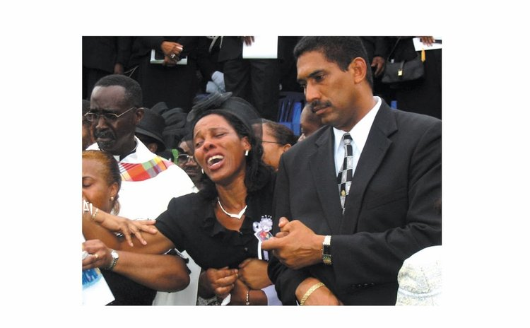 Mrs Charles at the funeral of Pierre Charles