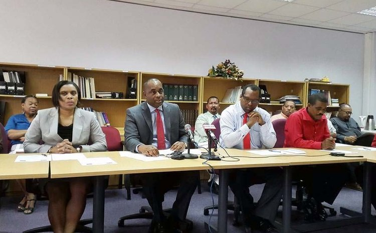 Prime Minister Skerrit and other Government officials at the signing ceremony