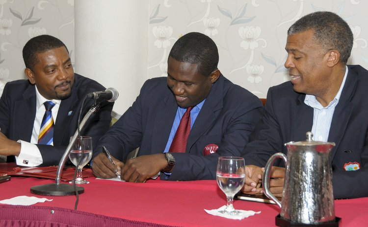 Hinds , centre, signs MOU with WICB officials