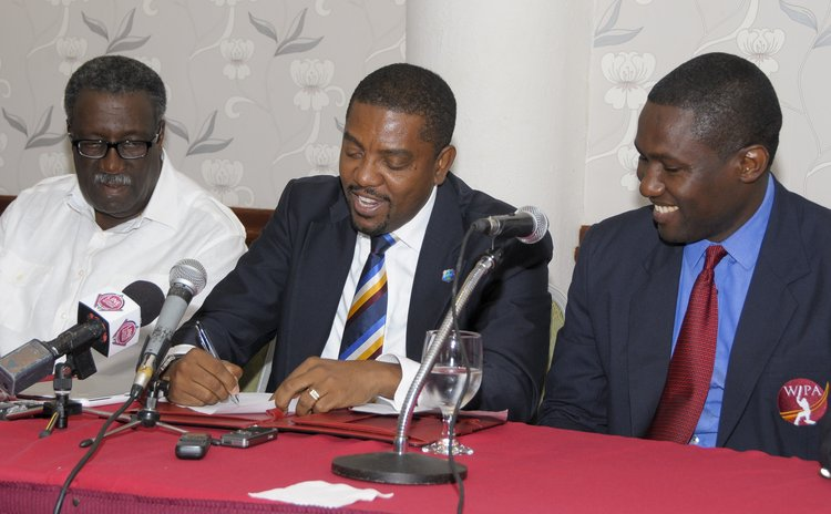 Dave cameron of the WICB, centre,and Wavell Hinds of the WIPA and Clive Llyod at the signing ceremony
