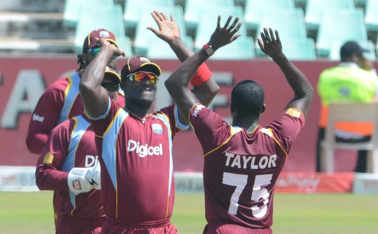 West Indies celebrate the taking of a wicket