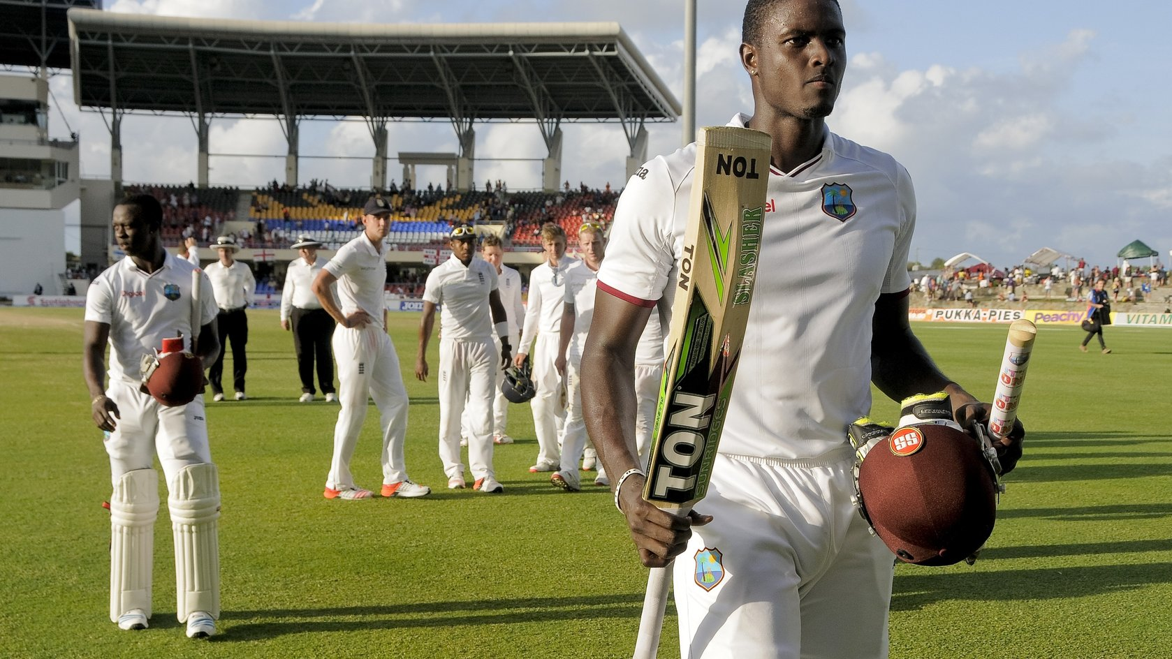 Jason Holder leaves the field after scoring maiden Test century
