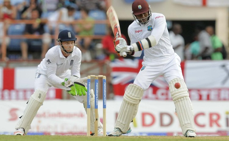 Samuels watches the ball closely