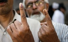 Fundermental rights of Democracy, Voting : photo of men showing fingers after voting