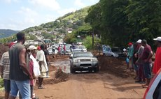 Drivers navigate damaged road in Massacre today