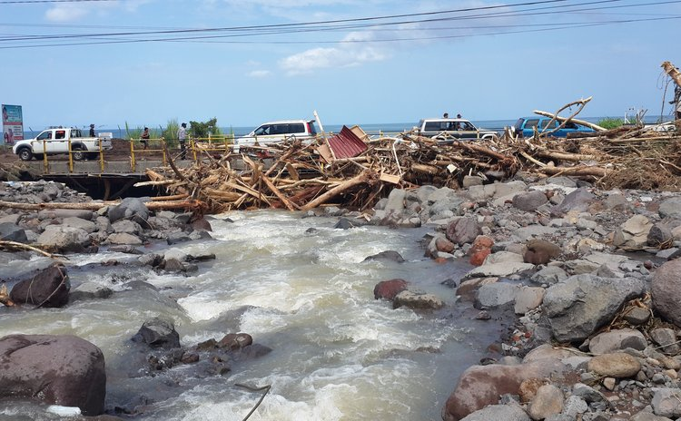 The Massacre river blocks the Massacre bridge with debris