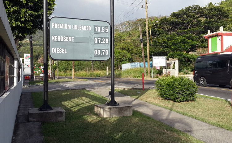 Sign showing latest changes in prices of gas, kerosene and diesel at the NP filling station in Canefield
