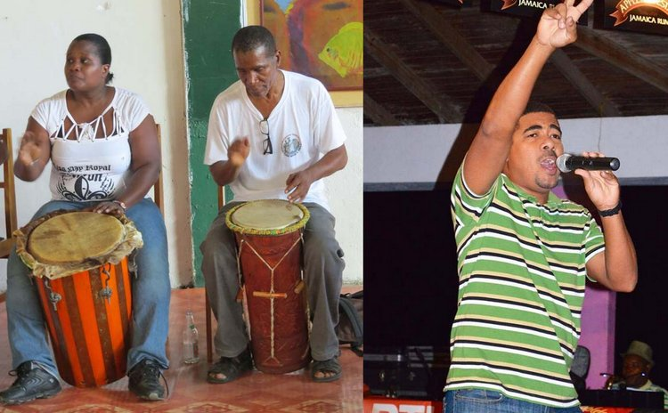 "Lynard Henderson (R) in Sibouli/Massacre Cultural Group drumming ensemble and Peter Letang performing as ""Mighty Pig-Tail"" (Photo Courtesy: Neo-Xpressions Inc)."