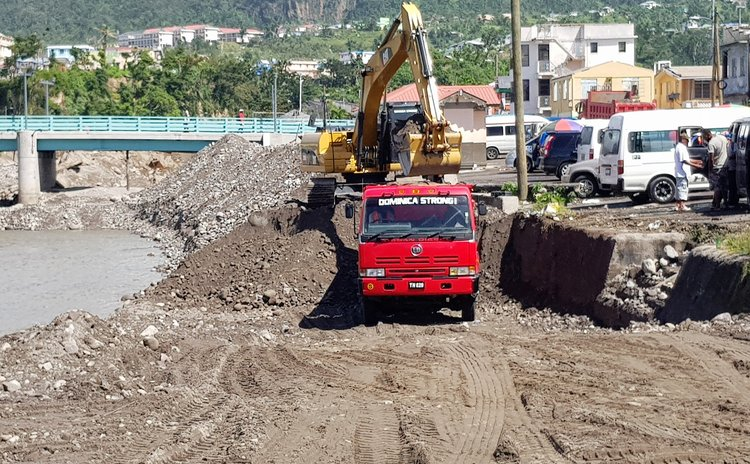 Dominica Strong truck working on bank of the Roseau River