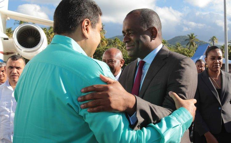 Skerrit and Maduro hug at the Douglas Charles Airport