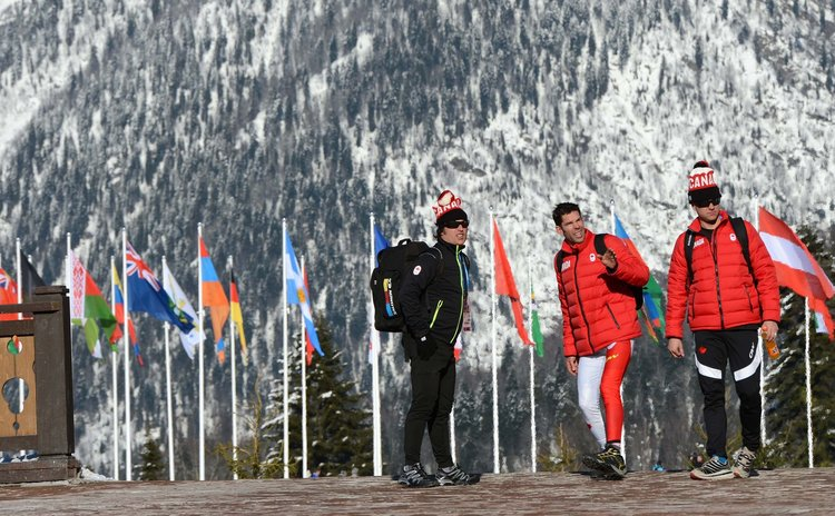 SOCHI, Feb. 5, 2014 (Xinhua) -- Canadian athletes walk in the Endurance Olympic Village called Sloboda in Sochi, Russia, Feb. 4, 2014. (Xinhua/Li Gang)