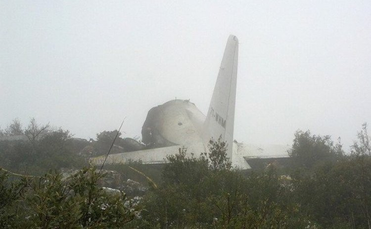 Feb. 11, 2014 (Xinhua) -- Photo taken on Feb. 11, 2014 shows the site of a military plane crash in Oum El Bouaghi Province, Algeria. As many as 76 people were killed on Tuesday when a C-130 Hercules m