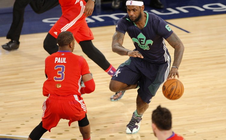 NEW ORLEANS, Feb. 17, 2014 (Xinhua) -- LeBron James of the Miami Heat (R) runs with the ball during the 2014 NBA All-Star Game against Western Conference in New Orleans