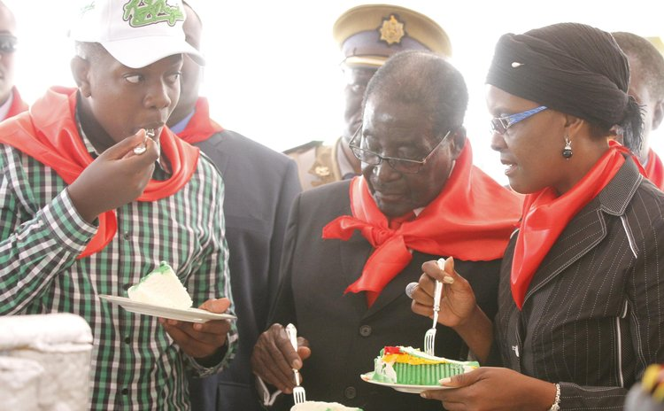 MARONDERA, Feb. 24 (Xinhua) -- Zimbabwe's President Robert Mugabe (C) eats a piece of cake with his wife Grace Mugabe and their son during celebrations to mark his 90th birthday  at Marondera, 75 km f