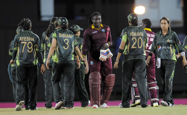 Taylor, the West Indies women cricket team captain shakes with the Pakistan team after the match