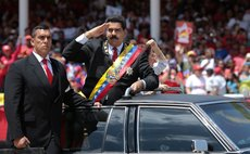 CARACAS, March 5, 2014 (Xinhua) -- Venezuelan President Nicolas Maduro (2nd-L) waves as he arrives to the civic-military parade in honour of late Venezuelan President Hugo Chavez. (Xinhua/AVN)
