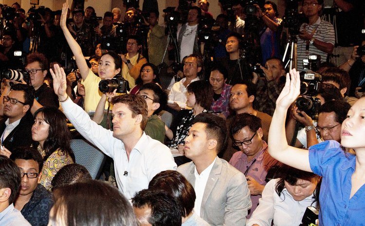 KUALA LUMPUR, March 12, 2014 (Xinhua) -- Reporters raise hands to ask questions during a news conference at a hotel near Kuala Lumpur International Airport in Sepang, Malaysia, March 12, 2014